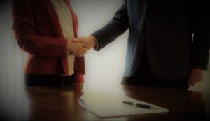 Two People Sign and Shake - M&A Advisors RoseBizInc